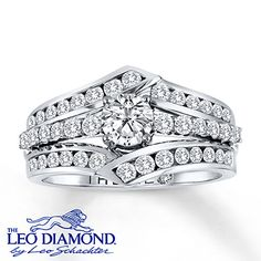 This thrilling engagement ring features a brilliant round Leo Diamond at its center that has been laser-inscribed with a unique Gemscribe® serial number. A row of round Leo Diamonds trickles from each side of the center with additional round Leo Diamonds set in the 14K white gold band above and below. The ring has a total diamond weight of 1 1/5 carats.