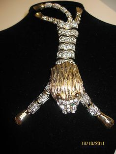 Articulated Lion shoulder pin goldtone clear & green rhinestones fully jointed