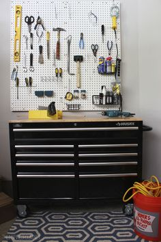 Garage tool organization with details on how to make a pegboard wall!