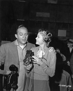 American singer and actor Bing Crosby  with American actress Grace Kelly circa 1953.