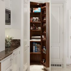 This corner larder is lined in walnut, with herb and oil racks attached to the inside of the door. It's part of a painted range from Chamber Furniture, where kitchens start at £40,000.