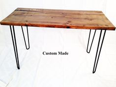 A classic modern industrial hairpin leg desk made just for you! The desk pictured is our Rosewood finish. Each desk measures 29 inches tall and 24-30 inches deep. Choose from over a dozen stunning custom finishes in widths from 46 to 60 inches. Our desks have that solid industrial look and feel. The hairpin legs are made of huge ½ inch solid iron with a durable powder coat finish. You can also choose to purchase the DIY desktop without legs. The top itself is approximately 1-1/4 inch thick…