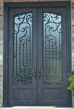 Beautiful custom wrought iron double entry door.