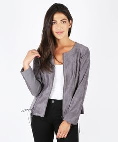 Our faux suede jacket is lightweight and super soft. A flared peplum hem with lace up detail gives this jacket a feminine and polished shape.
