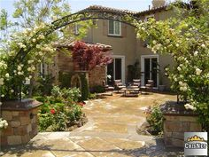 Beautiful landscaping, rose covered entry, Provence / Tuscany style yard