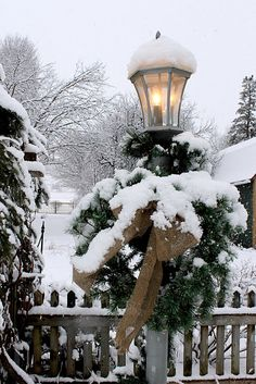 lamp post, burlap, greens and snow. perfect.