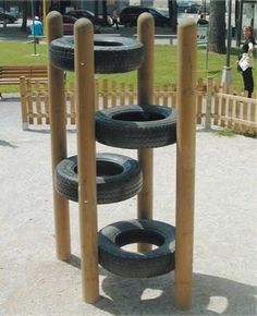 Tire climb, fun for the grandkids!  I also see a raised garden. Place large platters or ply wood in the bottoms, fill with potting soil or soil substitute and have at it. Would look nice with trailing plants.