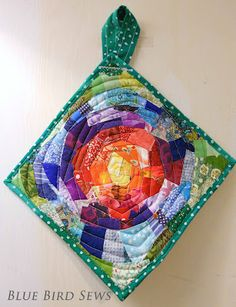 Sunshine potholder tutorial. Such a cool thing to do with little scraps. Looks like a mosaic of fabric.