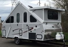 Top 2017 models of hard-side folding travel trailers keep benefits of tent pop-ups but at the same time offer advantage of fully enclosed, weather-protected hard-wall living space A Frame Trailer, Pop Up Camper Trailer, Popup Camper, Camper Trailers, Campers For Sale, Trailers For Sale, Rv For Sale, Home Made Camper Trailer, A Frame Camper