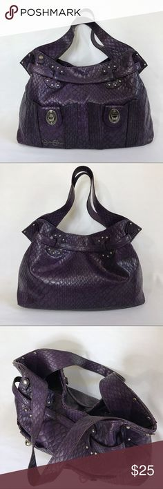 """Jessica Simpson Faux Croc Handbag Excellent used condition. Large Purple faux croc embossed shoulder bag with silver hardware. Snap closure. 2 front exterior pockets with snap closures. Interior is lined with a beautiful silky purple cheetah print and has 3 compartments (middle zips). 3 interior pockets (1 zips). Strap drop is approximately 9"""". Jessica Simpson Bags Shoulder Bags"""