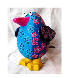 Navy blue papier-mache bird by Petey & Co., via Flickr