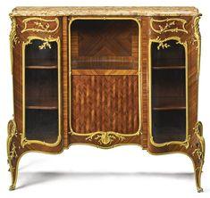François Linke French, 1855 - 1946 A gilt bronze-mounted kingwood and satiné cabinet de salon Paris, late 19th century