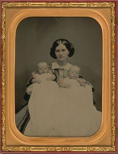 Twins - and I adore her hair - I'm going to guess late 1850s