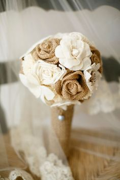 Rustic bouquet with burlap flowers: I love the look of this floral bouquet not only for a wedding but just for creating in the home. I love the idea of working with different types of fabrics and textures in fabrics. This DIY looks like it make some fun crafts for any home decor! Love it!