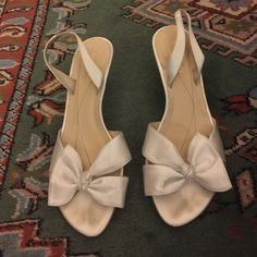 Kate Spade White Satin Bow Kitten Heels White satin bow heels from Kate Spade. Kitten heels. Worn for one occasion. Some staining/discoloration on inside of shoe, but none that can be seen when shoes are being worn. Size 6.5. kate spade Shoes Heels