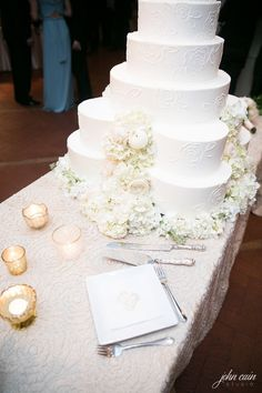 Classic white bride's cake by Fancy Cakes by Lauren | Beautiful flower design by Branching Out Events