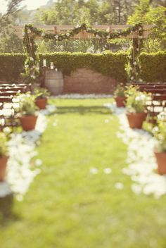 Elegant Backyard Wedding Ceremony. I like the idea of using floral arrangements/light paper as decorations.
