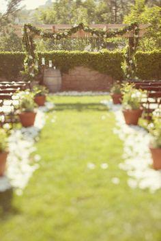 Elegant Backyard Wedding Ceremony. I like the idea of using floral arrangements/light paper as decorations.
