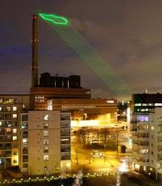 Information decoration on a city scale. Every night from the 22 to the 29 of February 2008, the vapor emissions of the Salmisaari power plant in Helsinki will be illuminated to show the current levels of electricity consumption by local residents. A laser ray will trace the cloud during the night time and turn it into a neon-style graph.    Nuage Vert is an artwork by Helen Evans & Heiko Hansen.  Via Sustain.