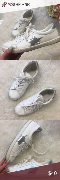 White Sneakers with Silver Stars Bought these and wore them just once and I'm sooo sad they are just a tad snug. White faux leather sneakers with two super cute silver metallic stars on the sides. Have light wear on the bottom from the one day I wore them but still super crisp & fresh! Would be best for an 8.5. ASOS Shoes Sneakers
