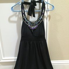 Halter top Candie's halter top. Dress up or down. Great for many seasons. Beautiful colors. NWT. Size XS Candie's Tops