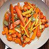 Chardonnay-Glazed Carrots    12345  Loved It?  ingredients  2  pounds assorted carrots  1  cup Chardonnay verjus or 3/4 cup white grape juice plus 1/4 cup white wine vinegar  1/2  cup honey  2  tablespoons unsalted butter  1  teaspoon kosher salt  2  cinnamon stick  2  bay leaves  2  tablespoons sliced chives