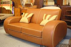 Art Deco Style Sofa Totally Glam At Leather Round Back Cigar Club Furniture Facelinkbox