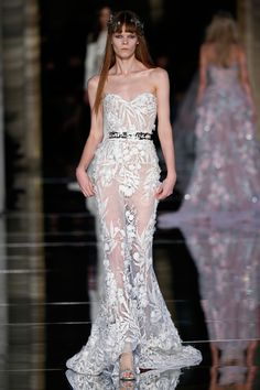 Zuhair Murad Couture Spring/Summer 2016  Structured cage bustier mermaid dress in white silk tulle, adorned with 3D shimmering climbing flowers