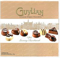 Guylian Opus Luxury Assortment | Opus Luxury Assortment features 16 Belgian chocolate truffles elegantly crafted by Guylian master chocolatiers to create a chocolate opera. Indulge in a symphony of flavors including the Guylian signature hazelnut filling, soft caramel filling, crunchy biscuit surrounded by vanilla cream, pear and mango ganache, smooth milk truffle, roasted hazelnut, and cappuccino cream. Each chocolate creation reflects a famous opera, from Romeo & Juliet, Magic Flute…