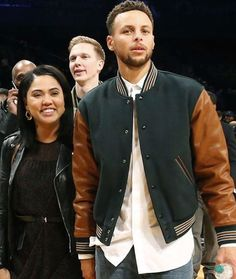 Stephen Curry Of the Golden State Warriors sits courtside during the second half of the Legends Classic College Basketball game between the...