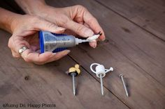 To keep mini figurines accessories in place within the garden, affix them to golf tees or nails with glue, and then insert the tee or nail into the soil.