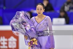 Mao Asada of Japan holds flowers in the Ladies free skating during the day three of the 2015 Japan Figure Skating Championships at the Makomanai Ice Arena on December 27, 2015 in Sapporo, Japan.