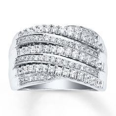 Sweeps of dazzling round diamonds flow across this 14K white gold anniversary band for her. The ring has a total diamond weight of 1 carat. Diamond Total Carat Weight may range from .95 - 1.11 carats.