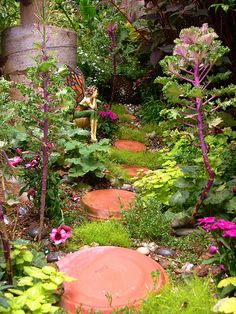 Make Your Own Fairy Garden: 10 Magical Ideas: A Matter of Scale...Whether you call them fairies, wee people, elves, or gnomes, it's fun to design fairy gardens to attract these enchanted beings to the landscape. You may not know how your fairy garden will turn out when you start to design it, but if you're a gardener, you know that no respectable fairy would inhabit a land without flowers!...