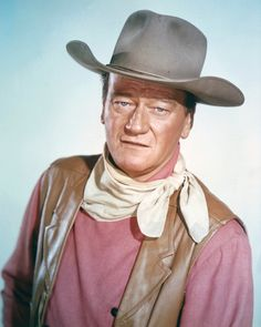 Notable May 26 Celebrity Birthdays | Legendary American actor John Wayne, space shuttle Challenger astronaut Sally Ride, English guitarist Mick Ronson, jazz legend Miles Davis, U.S. Gunsmoke actor James Arness, 'Star Wars' actor Peter Cushing, and actor/singer Al Jolson were all born on this day in history.