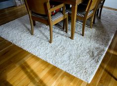 DIY your own area rug. Get carpet remnants cut at your local carpet dealers to the dimensions you want. They are anxious to get rid of leftover carpet and u can get a good deal.Check on the cost of having it bound there, this site also offers a super easy binding you can buy and do yourself using a got glue gun.
