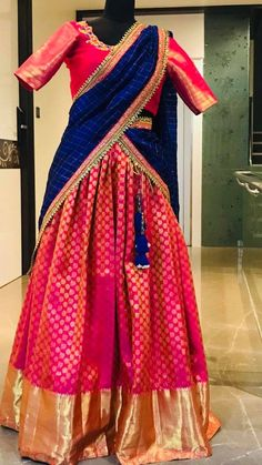 Beautiful pink color kanjiaram lehenga and blouse with royal blue color dupatta. Blouse with floret lata design hand embroidery work on neck line 10 March 2018 Lehenga Saree Design, Half Saree Lehenga, Kids Lehenga, Lehnga Dress, Indian Lehenga, Lehenga Designs, Long Gown Dress, Salwar Designs, Bridal Lehenga