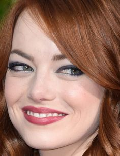 Close-up of Emma Stone at the 2015 Golden Globe Awards. http://beautyeditor.ca/2015/01/12/golden-globes-2015