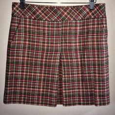 plaid skirt Wool blend (63% wool, 37% rayon) fully lined green, red and yellow mini skirt. Front pockets, front pleat and side zipper closure. Approximate length from hem to waistline is 17 inches. In excellent condition Ann Taylor Skirts Mini