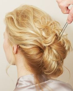 Spiral curl all. Divide into two sections and loosely twist each. Cross the two sections and fold up and pin.