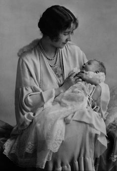 The Queen Mother and Princess Elizabeth - April 21, 1926  The Queen Mum gazes lovingly at her baby daughter, the future Queen Elizabeth II of England.