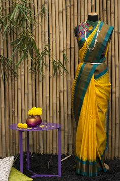Yellow…the color of marigolds and merry times. Don this beautiful yellow drape in Gadhwal pure silk and captivate your onlookers. The sea green border with a wispy orange band and temple motifs in leaf green are the creative combinations of some Gadhwal weavers quietly working their magic at the loom. The grand golden sheen on sea green pallu completes this beauty.  #houseofblouse #festive #saree #puresilk #blouse #indianwear #india #fashion #bollywood