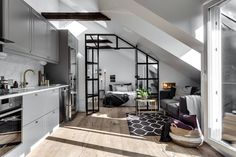 [Room] Small attic apartment in Stockholm, Sweden uses an industrial glass wall to partition the bedroom from the rest of the space. × [Room] Small attic apartment in Stockholm, Sweden uses an industrial glass wall to partition the be Industrial Apartment, Attic Apartment, Attic Rooms, Attic Bathroom, Studio Apartment, Attic Playroom, Stockholm Apartment, Dream Apartment, Attic House