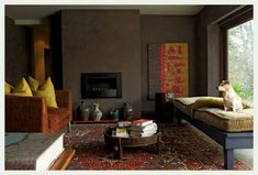 i love the color, the rug, the pops of color.  this room is fantastic!