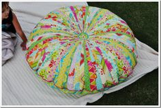 Jelly Roll Floor Pillow - tutorial here http://www.modabakeshop.com/2011/07/jelly-roll-floor-pillows.html