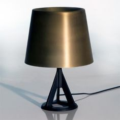 """Base Table Lamp by Tom Dixon   brass and iron. this is such a dude lamp but i love it a little more each time i look at it. 10.6""""d x 15.5""""h."""