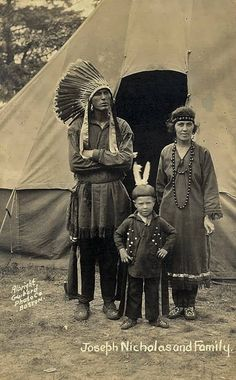 Joseph A. Nicholas with his wife, Margaret Bassett-Nicholas and their son, John Nicholas in the Indian Village at the Plymouth Tercentenary Celebration in Plymouth, Massachusetts - Passamaquoddy - 1921