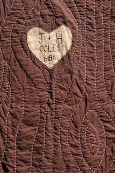 "Oh my goodness I would love to give this to Jamie for some holiday. Or get it as a wedding gift.  LOVE IT  Tree quilt with wedding date and initials ""carved"" into the tree"