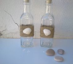 Beach Decor Decorative Shell Bottles - for oil & vinegar? Would put a starfish on one so they're different
