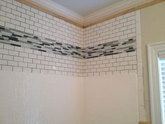 I don't like the tile or pattern, but like the idea of tiling about shower insert, matching tile back splash from sink. Dress up the area above your fiberglass shower insert. Featured is subway tile design with glass inserts. Luxury Bathroom Faucets, Shower Surround, Fiberglass Shower, Trendy Bathroom, Bathroom Makeover, Bath Remodel, Bathroom Renovations, Bathroom Shower, Bathroom Redo
